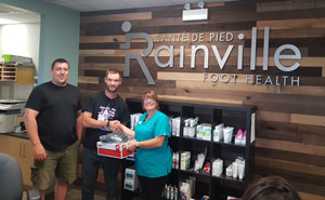 New Balance shoes donated by Rainville